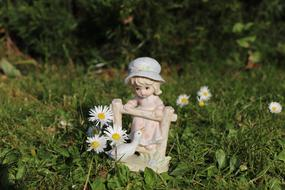 Girl and bird garden figurine