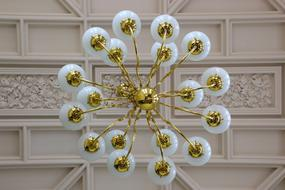 white gold chandelier in the interior
