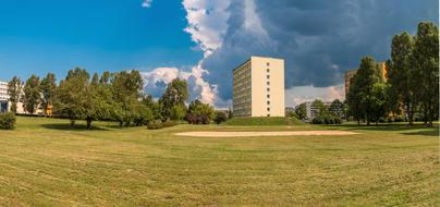 building of Kielce University of Technology in park at summer, poland