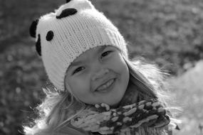 monochrome photo of a girl in a white black hat