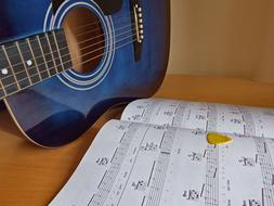 Guitar blue and music book
