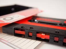 photo of black and red audio cassette