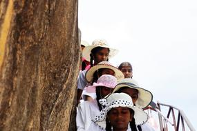 photo of female students in hats in Sri Lanka