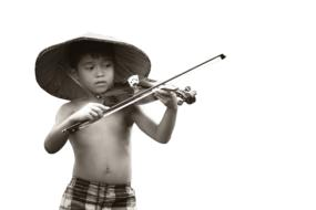 photo of a vietnamese boy with a violin